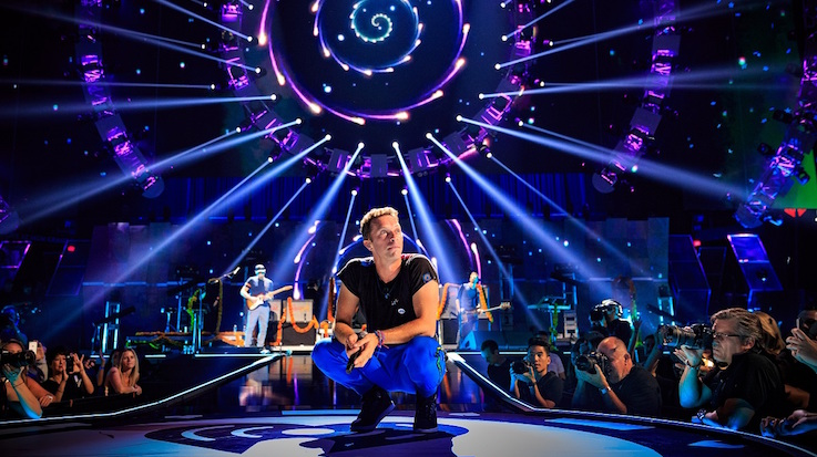 Musician Chris Martin of Coldplay performs onstage at the 2015 iHeartRadio Music Festival at MGM Grand Garden Arena on September 18, 2015 in Las Vegas, Nevada. (Photo by Christopher Polk/Getty Images for iHeartMedia)